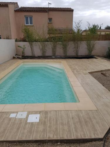 Plage de piscine motif bois - Béton imprimé